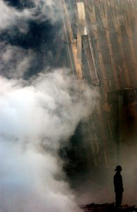 010914-N-1350W-004 New York, N.Y. (Sept. 14, 2001) -- A solitary fire fighter stands amidst the rubble and smoke in New York City. Days after a Sep. 11 terrorist attack, fires still burn at the site of the World Trade Center. U.S. Navy Photo by Photographer's Mate 2nd Class Jim Watson. (RELEASED)